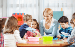 mom playing with kids in classroom